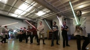"""""""Oh, Mom, they've been passing out lightsabers at OUR church too."""""""