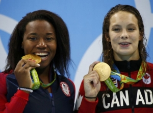 And she tied with a Canadian swimmer, and they were both so happy, and it was SO COOL!